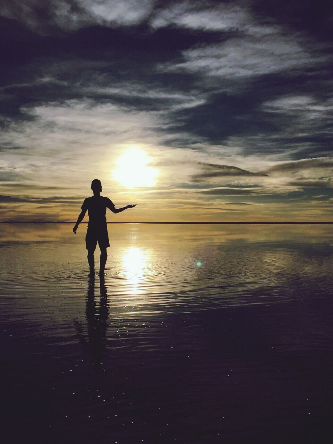 The Great Outdoors - 2017 EyeEm Awards Salar De Uyuni Like An Another Universe Sun Beauty In Nature Water One Person Standing Horizon Over Water