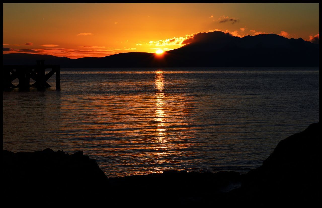 Sunset over Arran  Isle Of Arran  Nature Reflection Orange Color Water Beauty In Nature Scenics Sky Sun Silhouette No People Outdoors Sunset_collection Sunset #sun #clouds #skylovers #sky #nature #beautifulinnature #naturalbeauty #photography #landscape Sunset Silhouettes EyeEm Gallery Eye4photography  EyeEmBestPics EyeEm Best Shots EyeEm Water Reflections Water_collection Pier