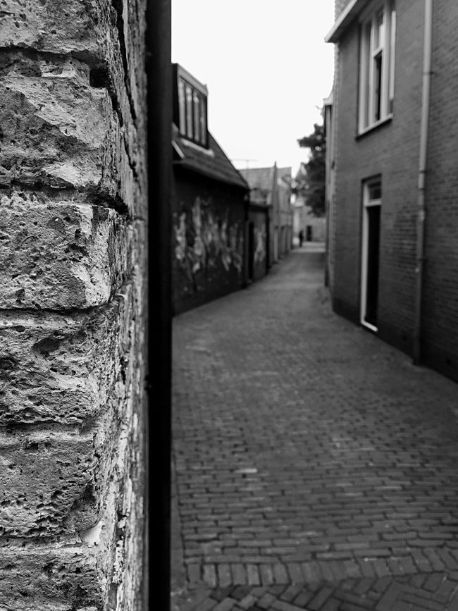 Just Around The Corner Peeking Urban Street Life B&w Wall Grunge
