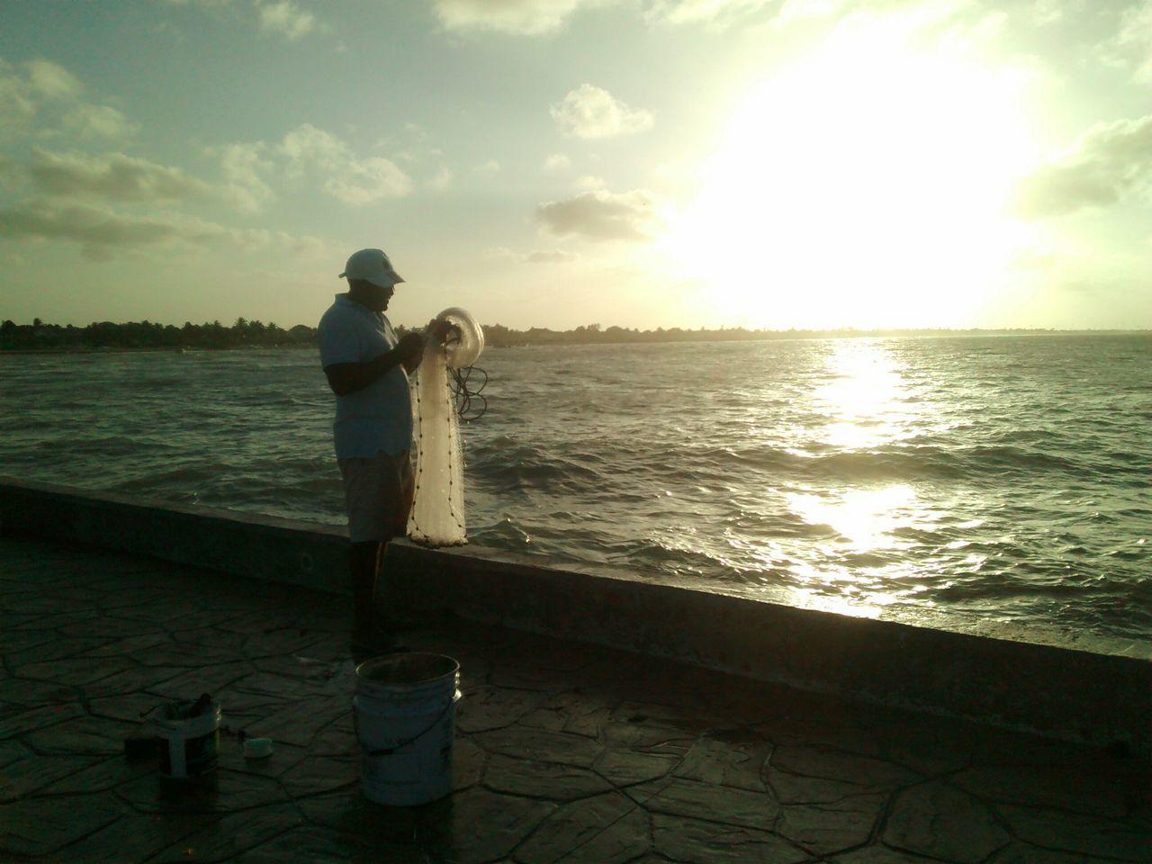 Fisherman Fishing Net Fishing Time Sunset Silhouettes People And Places People And Nature Sealife♡ Yucatán, México PuertoProgresoYucatan First Eyeem Photo