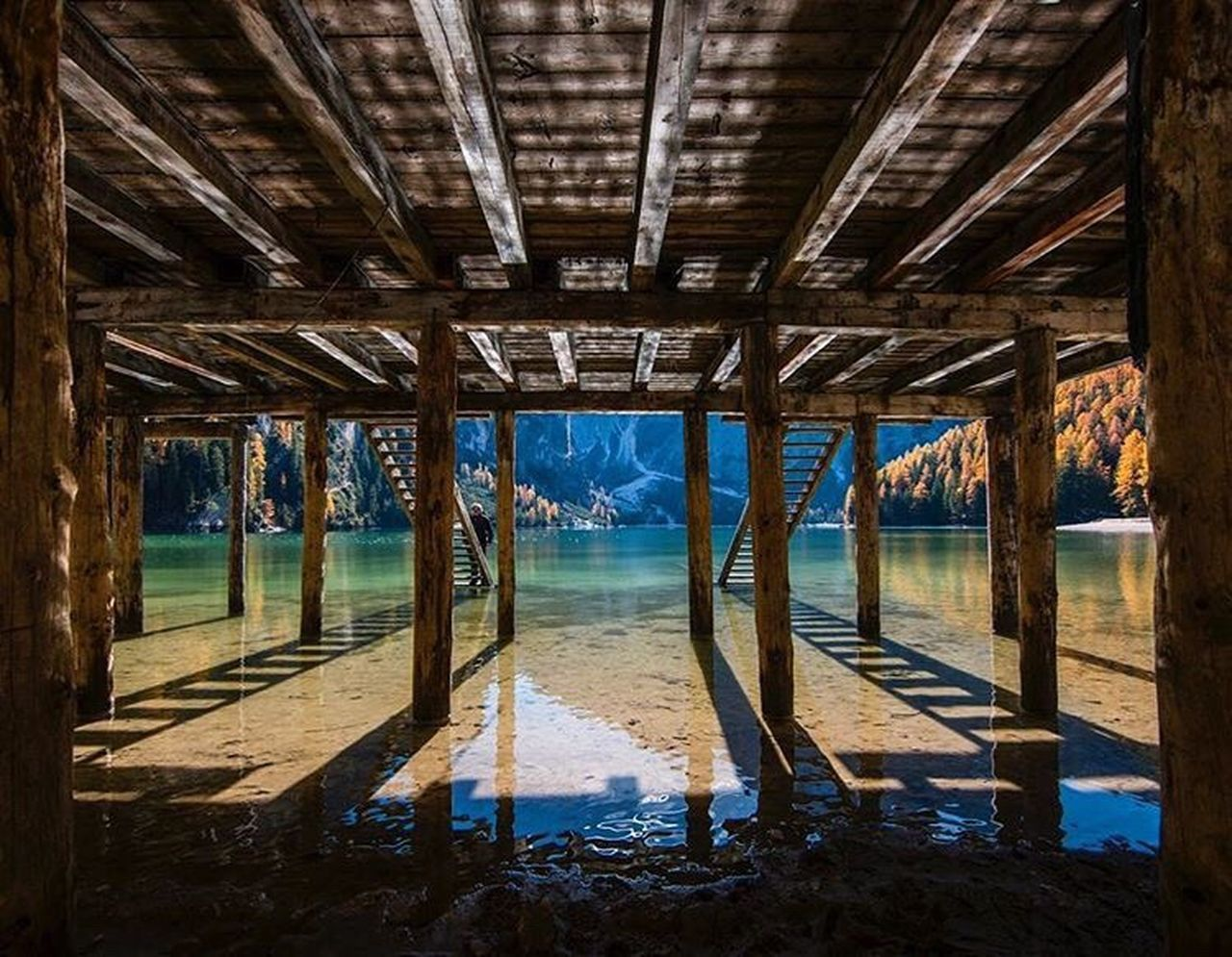 underneath, water, pier, architecture, beach, sea, nature, built structure, below, architectural column, day, no people, indoors, sky
