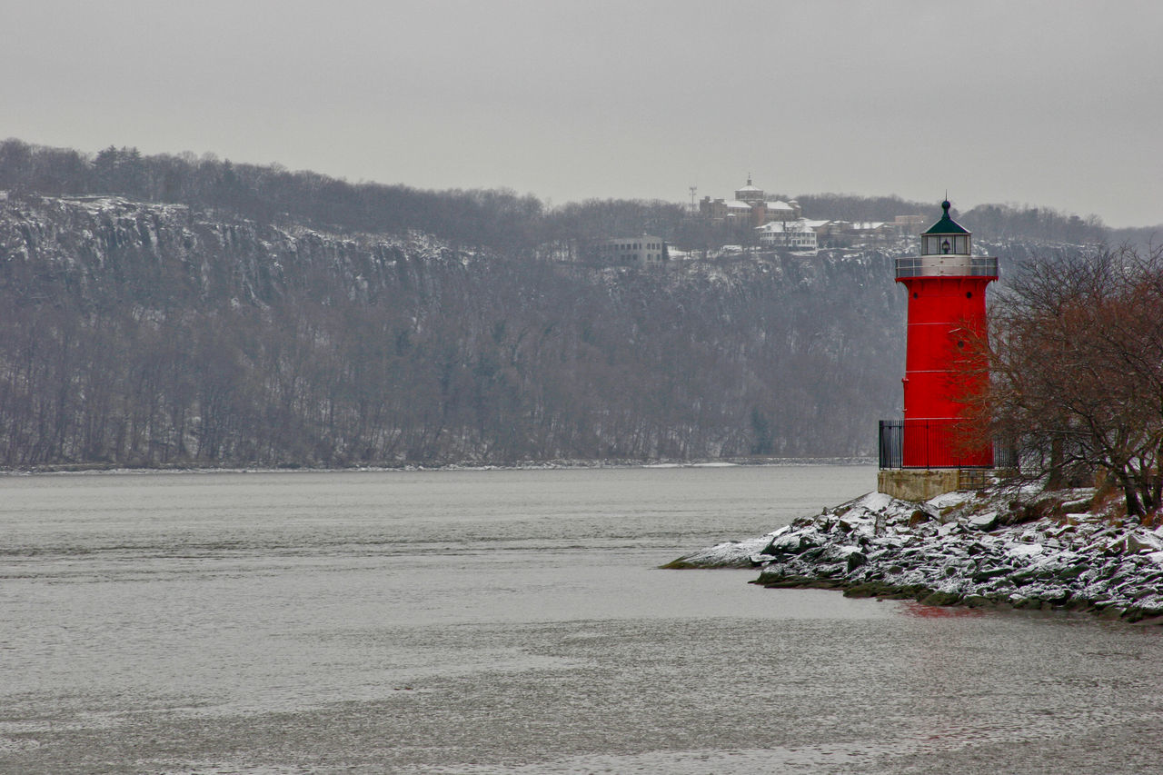 Lighthouse By Hudson River During Winter
