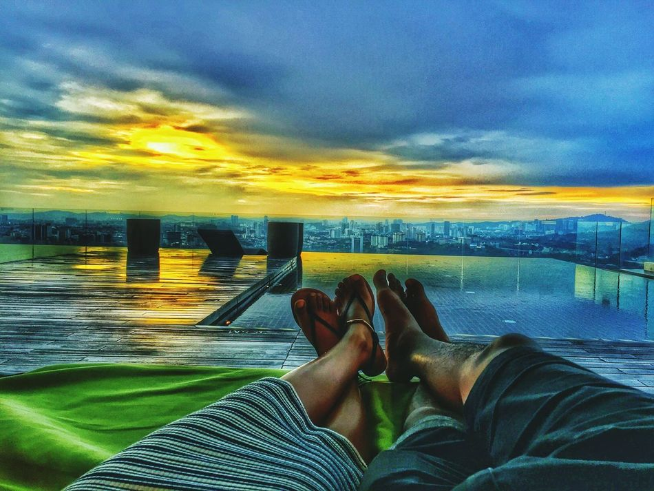 Human Leg Low Section Human Body Part Personal Perspective Human Foot Limb Cloud - Sky Sunset Water Beach One Person Barefoot Lifestyles Sea Sky Relaxation Leg People Adults Only Adult Chillaxing EyeEm Diversity