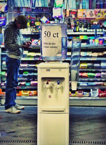 People Watching Kiosk Life Water Dispenser Ripoff in Bonn