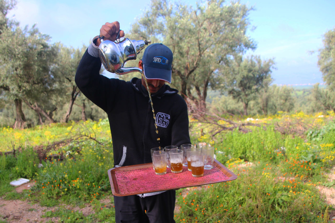 Adult Day Entertainment Field Lifestyles Marrocan Style Marrocan Whiskey Men Nature Outdoors Pouring Tea Real People Tea Pouring