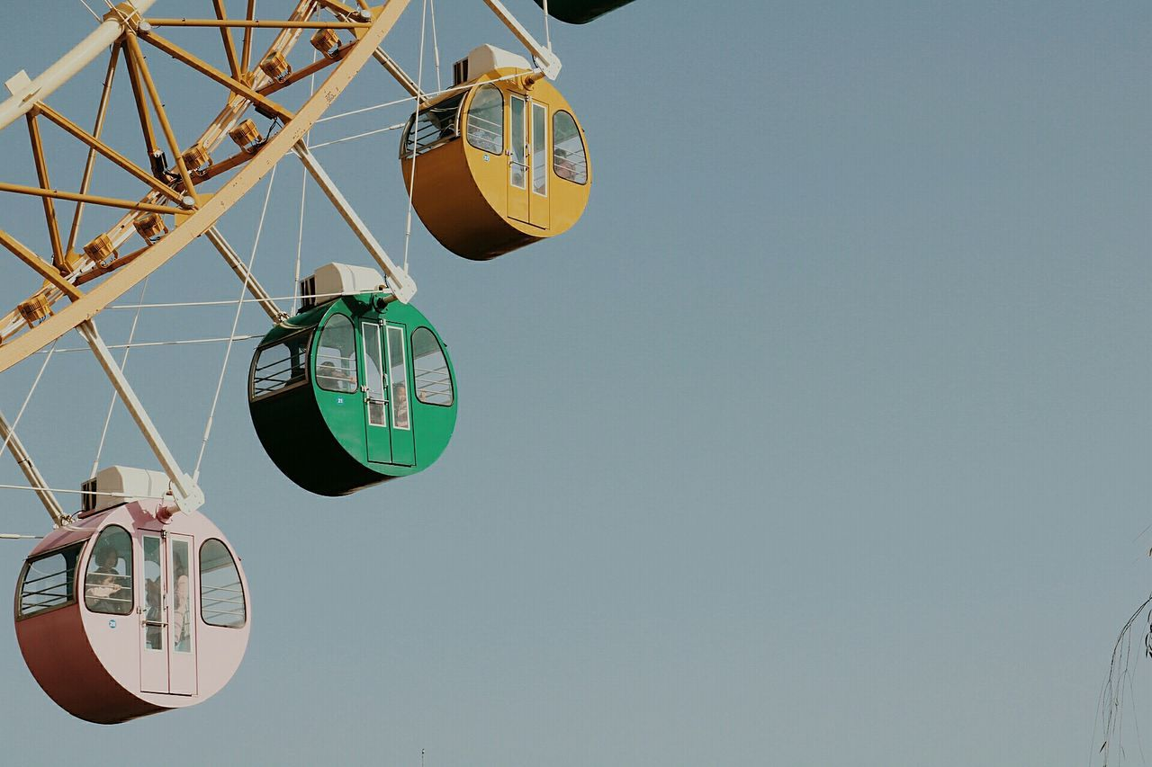 hanging, clear sky, day, ferris wheel, low angle view, outdoors, no people, sky
