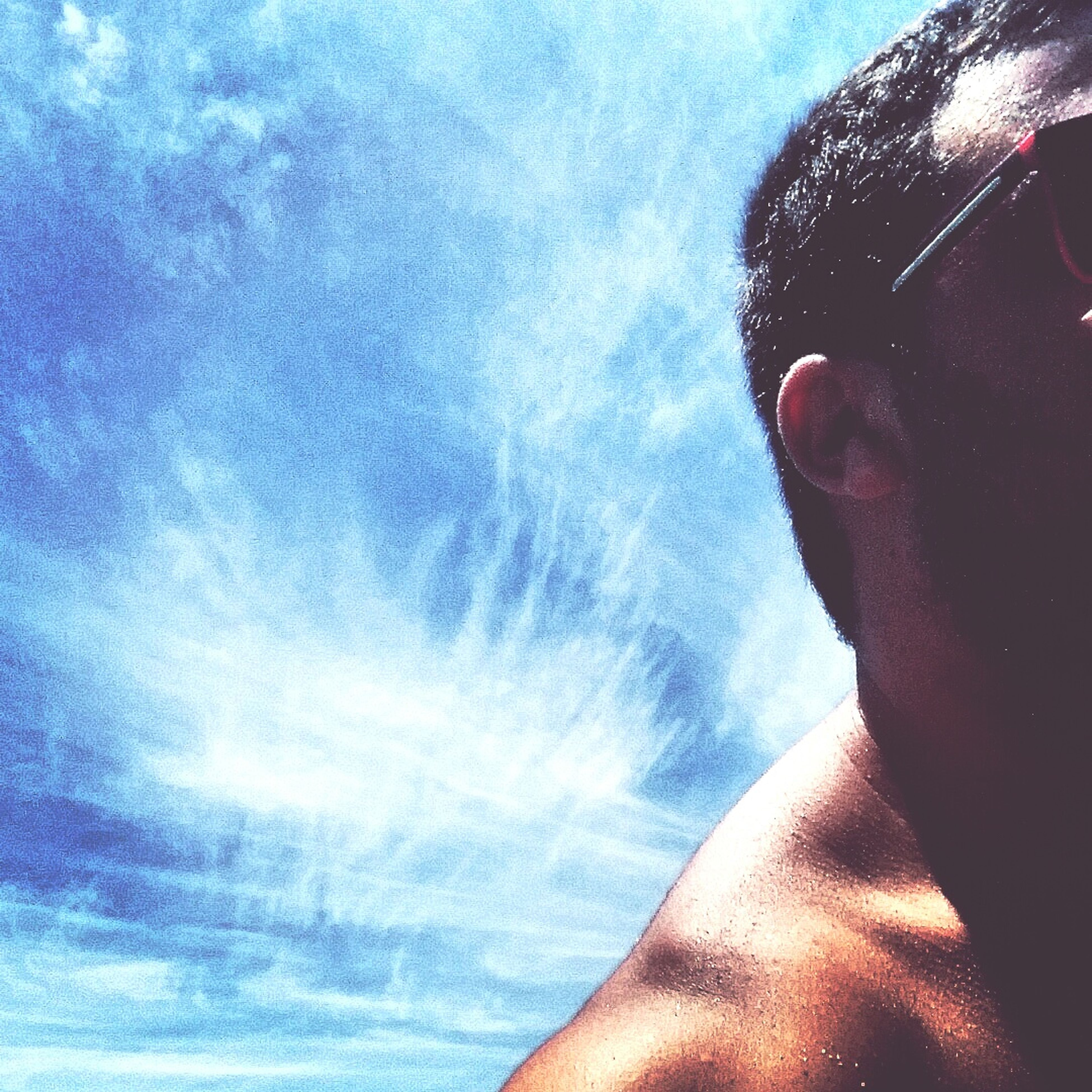 lifestyles, leisure activity, part of, person, personal perspective, sky, cropped, men, close-up, unrecognizable person, headshot, blue, day, cloud - sky, human finger
