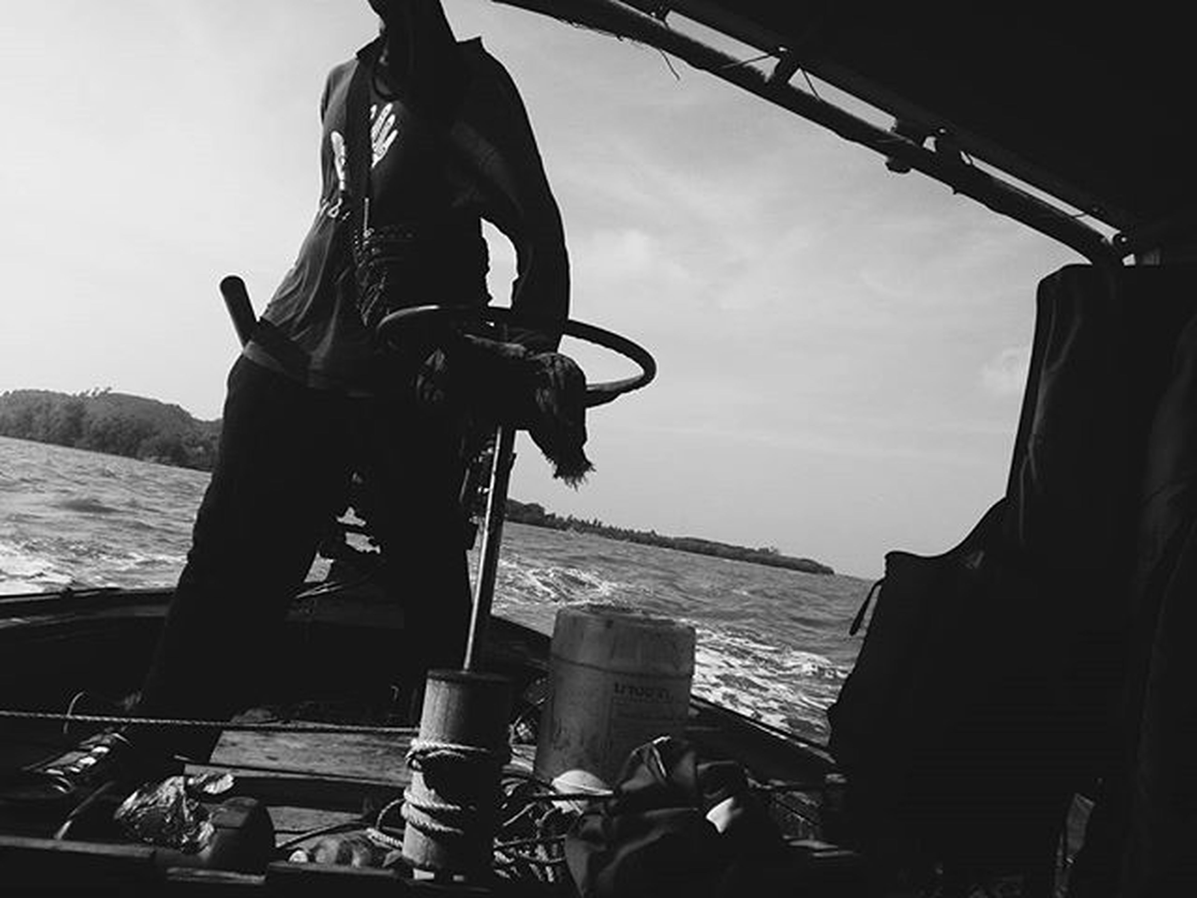 men, water, nautical vessel, transportation, mode of transport, lifestyles, sea, leisure activity, sky, travel, boat, rear view, day, sitting, standing, outdoors, occupation