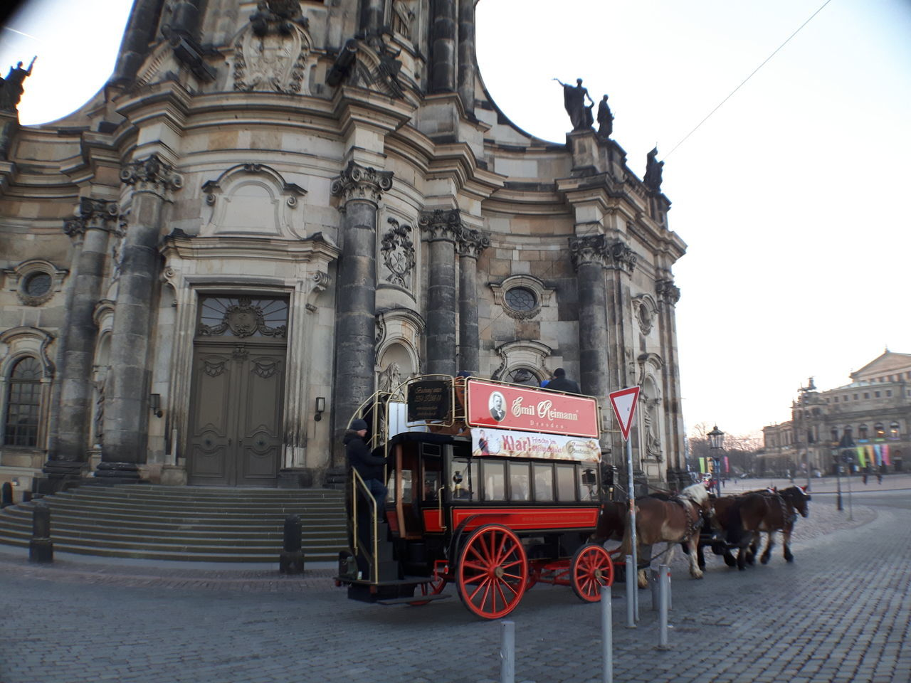 Animal Themes Architecture Carriage City Day Domestic Animals Horse Horse Cart Horsedrawn Mammal One Animal Outdoors People Tourism Town Square Travel Destinations Working Animal