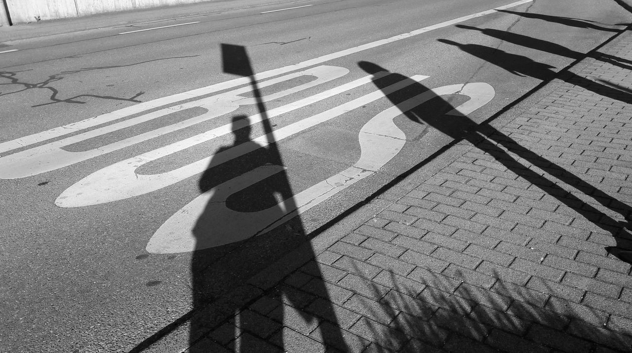 shadow, real people, sunlight, focus on shadow, high angle view, day, outdoors, road, one person, leisure activity, lifestyles, men, low section, people