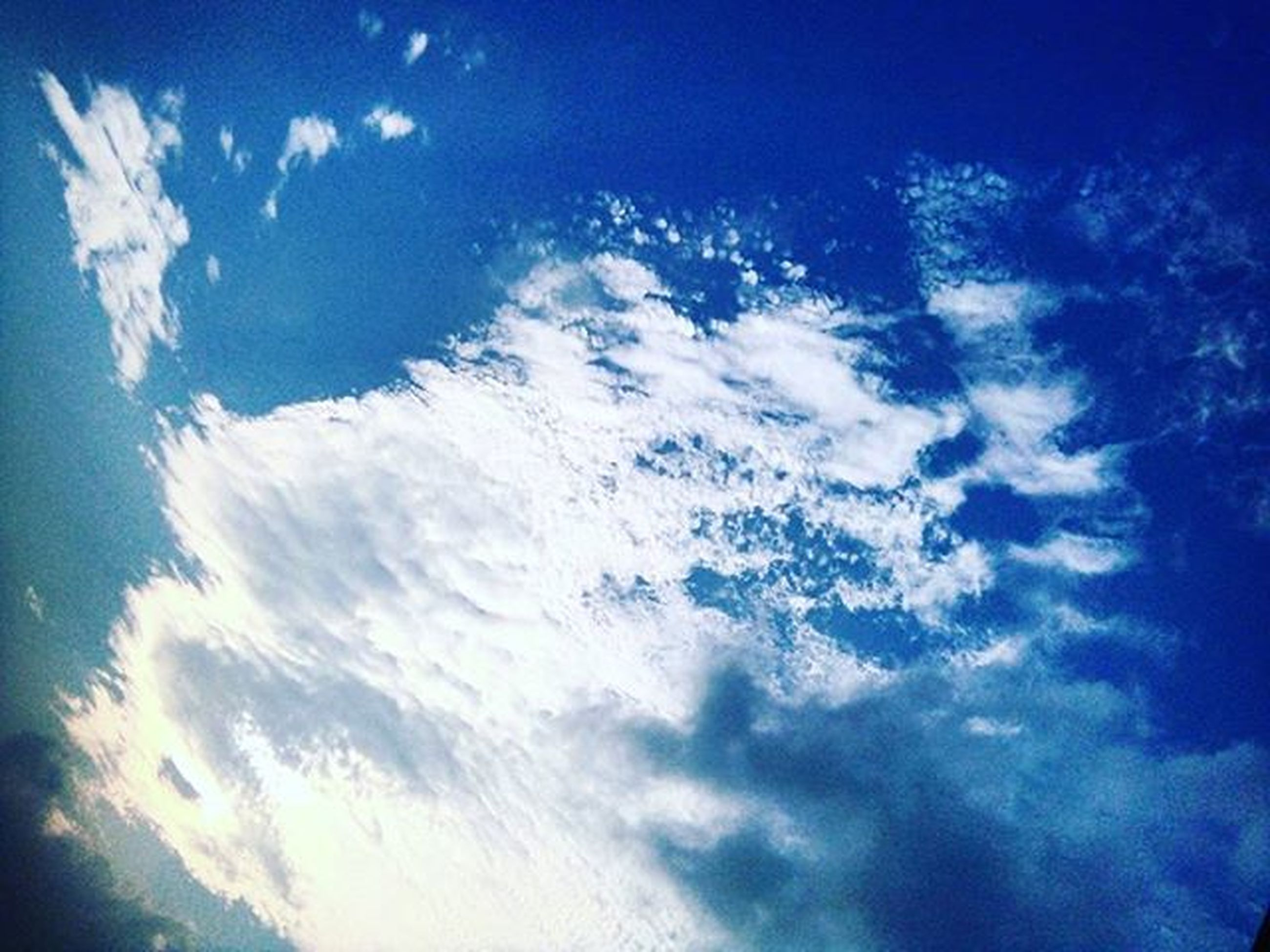 blue, sky, cloud - sky, low angle view, beauty in nature, scenics, nature, tranquility, sky only, tranquil scene, idyllic, cloudscape, cloud, sunlight, outdoors, cloudy, no people, aerial view, sunbeam, majestic