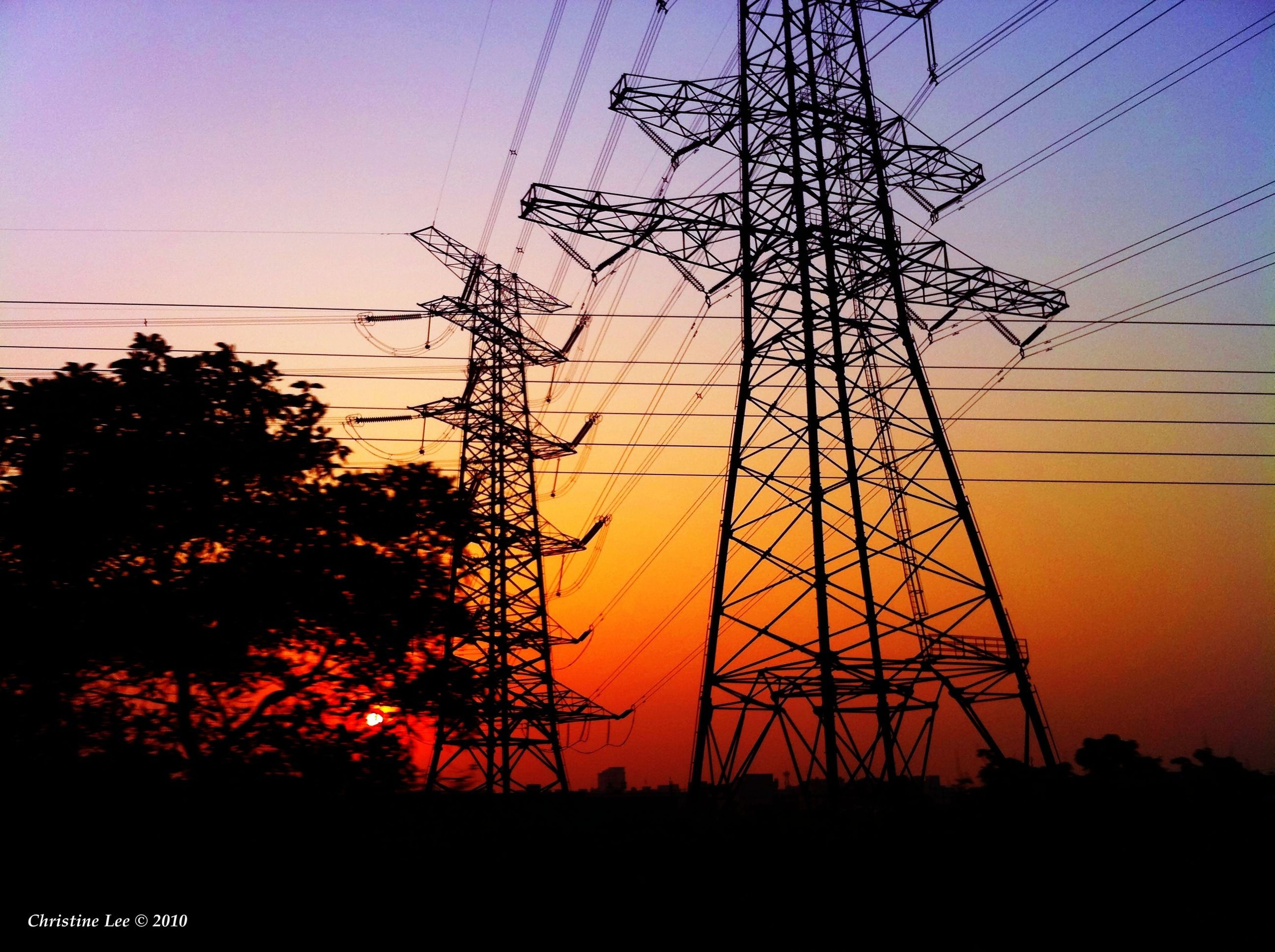 electricity pylon, power line, silhouette, sunset, power supply, electricity, fuel and power generation, technology, connection, cable, low angle view, tree, sky, orange color, nature, clear sky, power cable, dusk, beauty in nature, tranquility