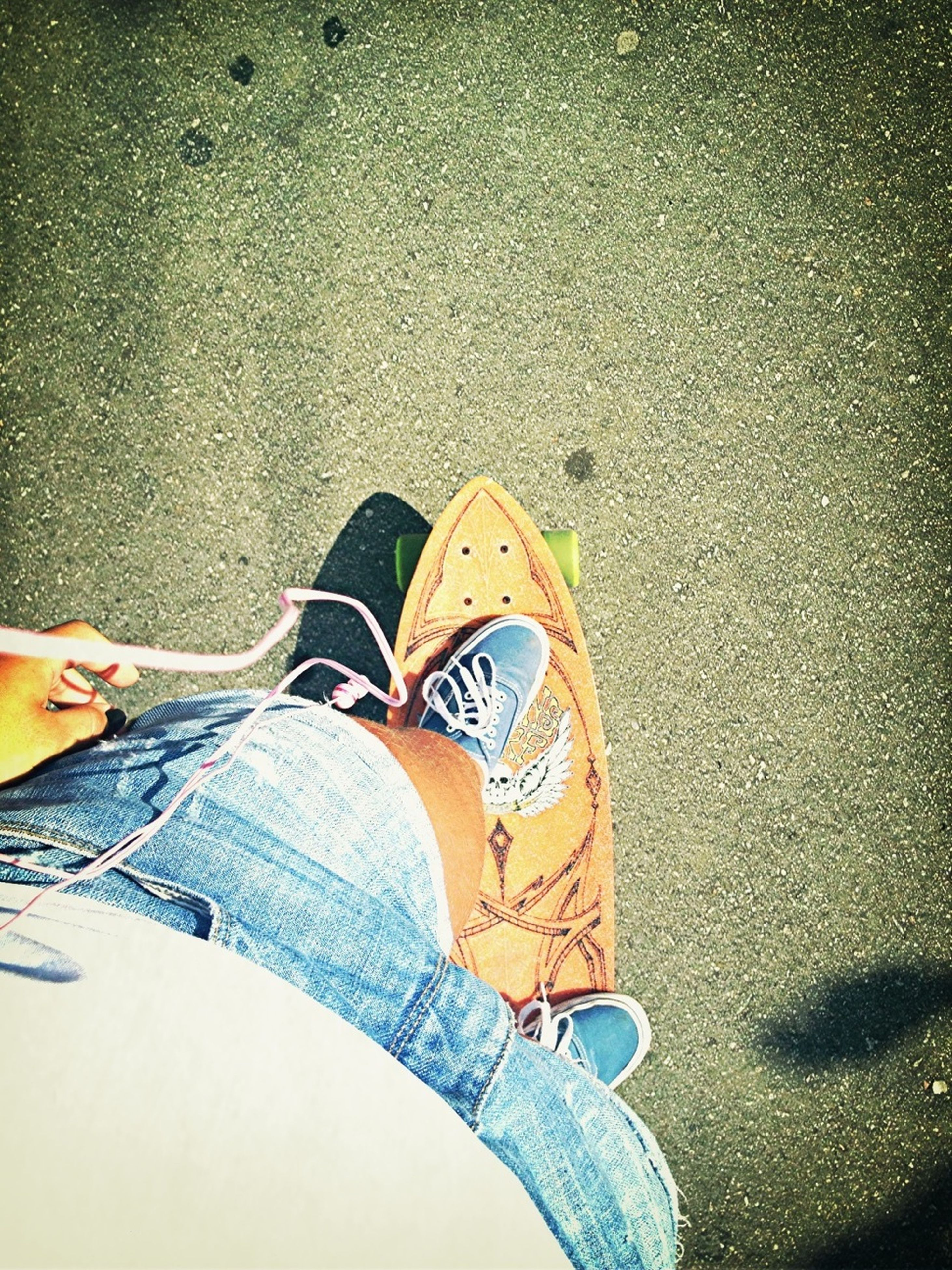 low section, person, shoe, lifestyles, personal perspective, standing, casual clothing, jeans, leisure activity, men, footwear, high angle view, street, human foot, yellow, sitting