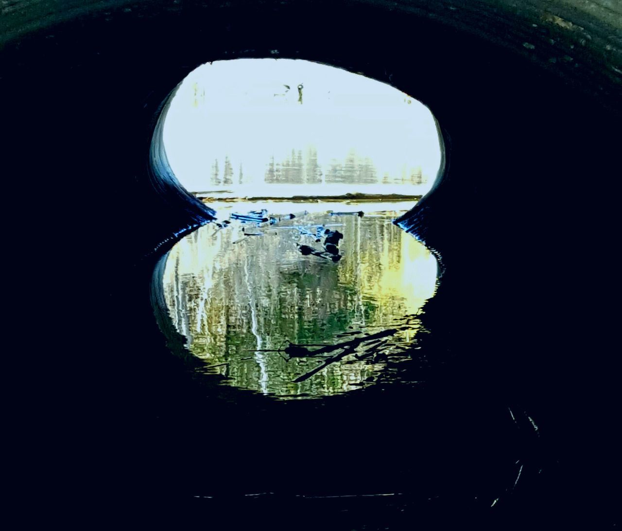 Looking Through A Culvert Water Reflections