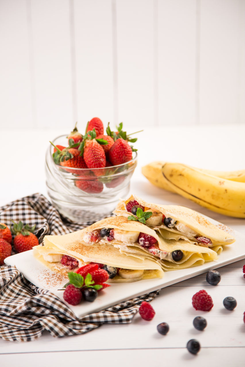 fruit, strawberry, food and drink, raspberry, berry fruit, freshness, food, banana, healthy eating, bowl, no people, dessert, sweet food, blueberry, plate, indoors, red, close-up, ready-to-eat, day