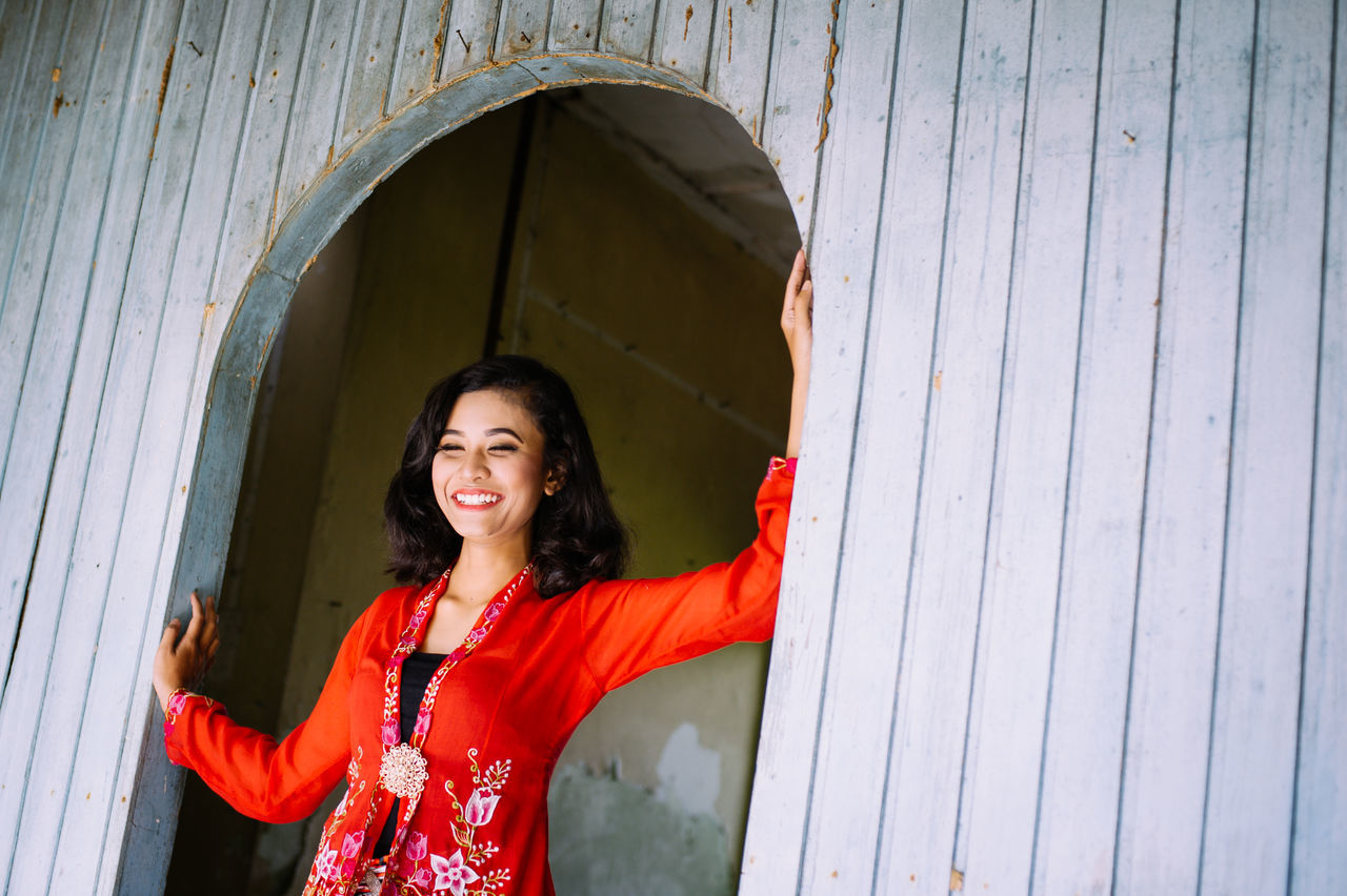Adult Adults Only Architecture Beautiful Woman Built Structure Cheerful Day Front View Happiness Leisure Activity Lifestyles Looking At Camera Mid Adult Mid Adult Women One Person Outdoors People Portrait Real People Smiling Standing The Portraitist - 2017 EyeEm Awards Waist Up Young Adult Young Women