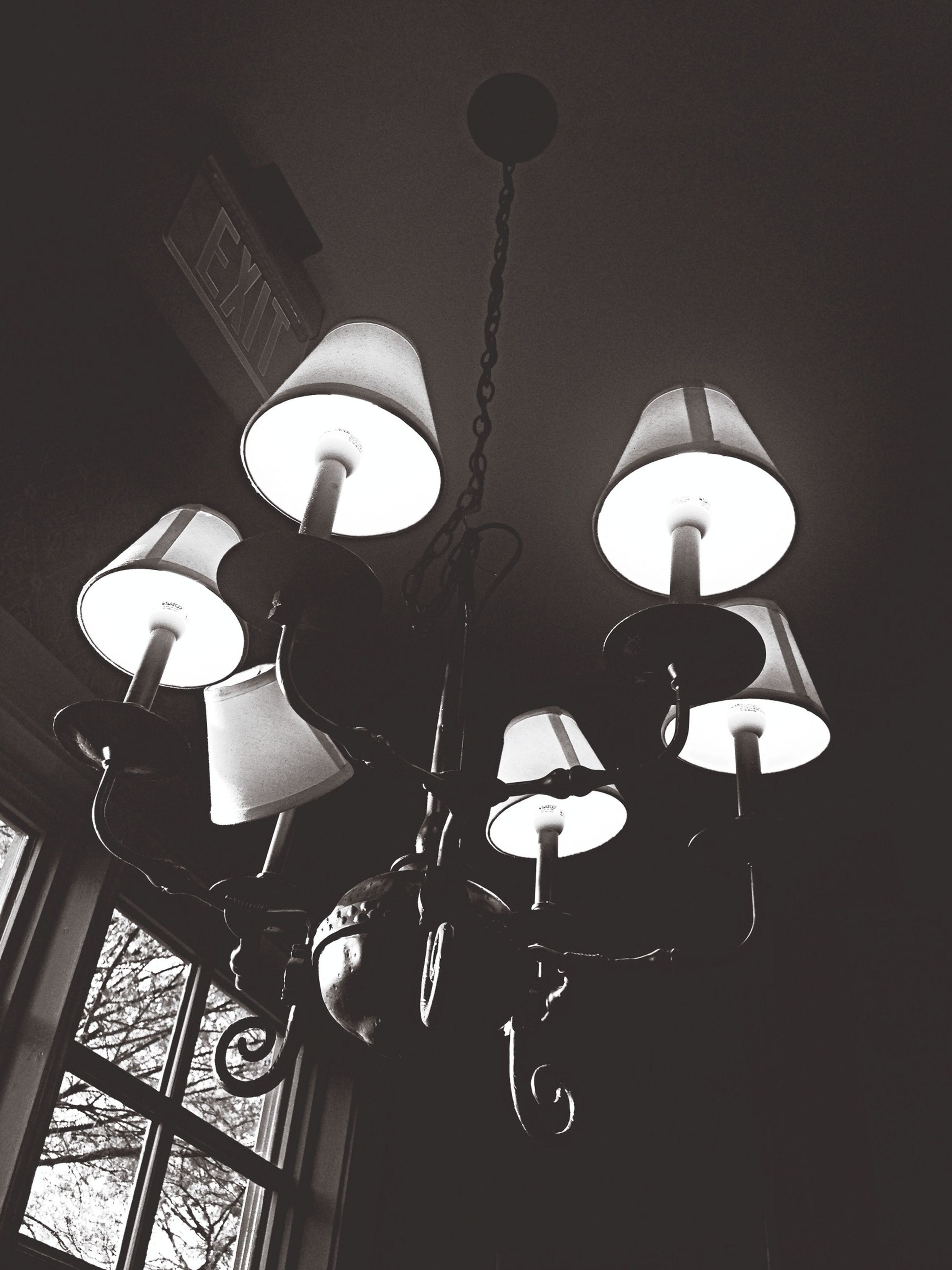 lighting equipment, low angle view, illuminated, electric lamp, electricity, hanging, indoors, street light, electric light, ceiling, lamp, built structure, architecture, decoration, no people, night, lantern, religion, light - natural phenomenon, wall - building feature