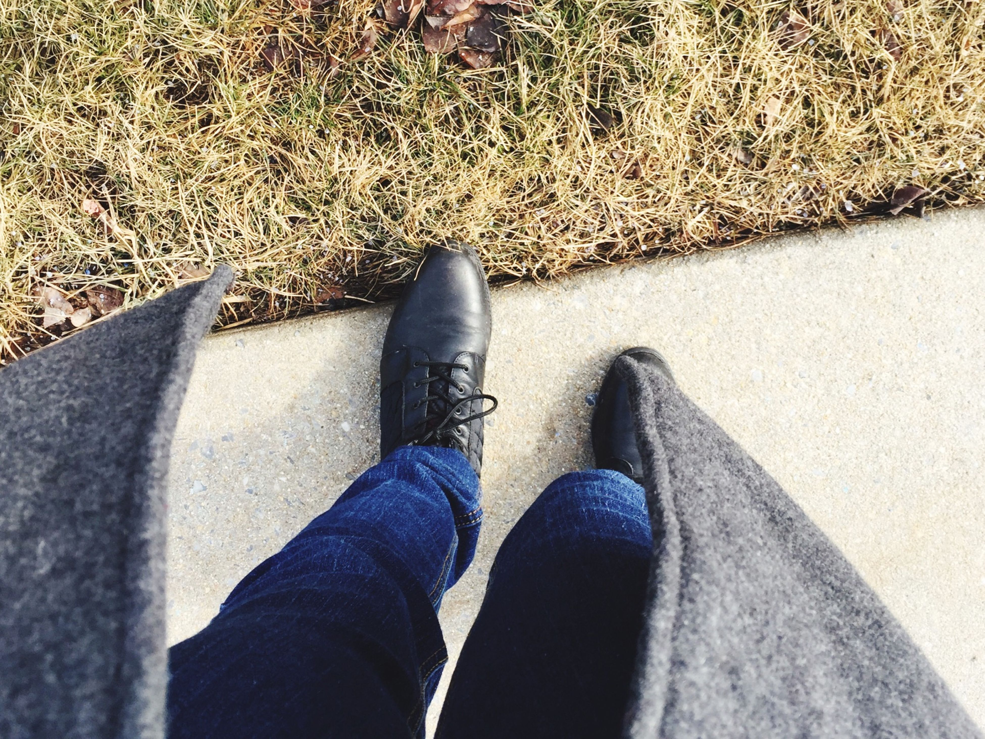 low section, person, shoe, personal perspective, high angle view, footwear, human foot, jeans, part of, standing, street, directly above, lifestyles, unrecognizable person, pair, road, outdoors