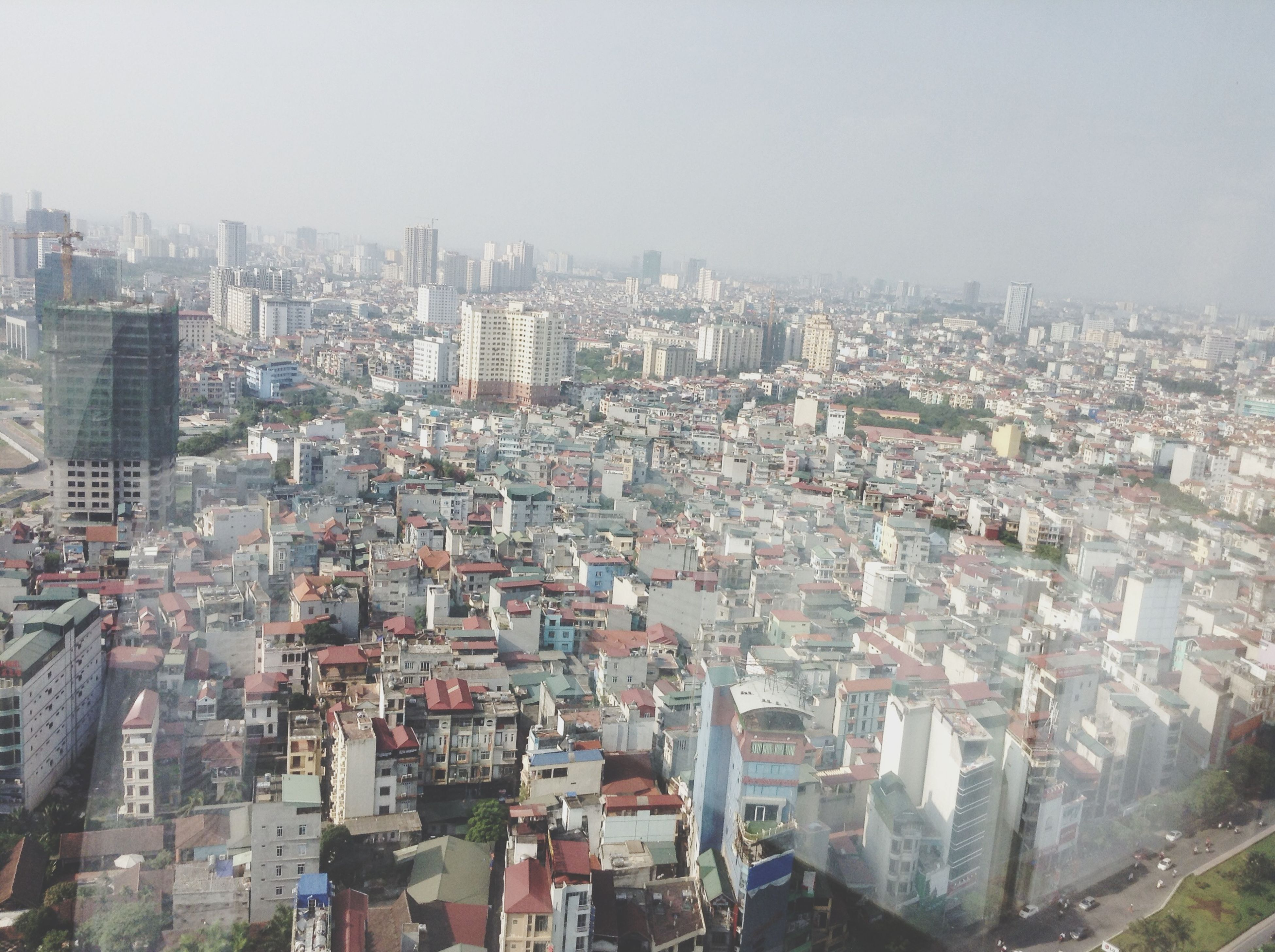 building exterior, architecture, built structure, cityscape, crowded, city, residential district, high angle view, clear sky, residential structure, residential building, copy space, roof, community, no people, day, outdoors, skyscraper, sky, house