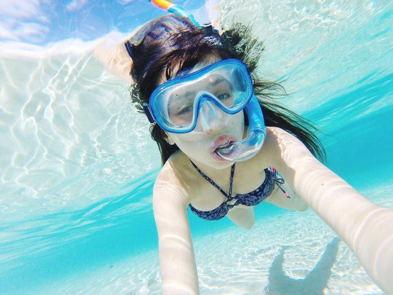 Portrait Of Young Woman In Bikini Snorkeling In Sea