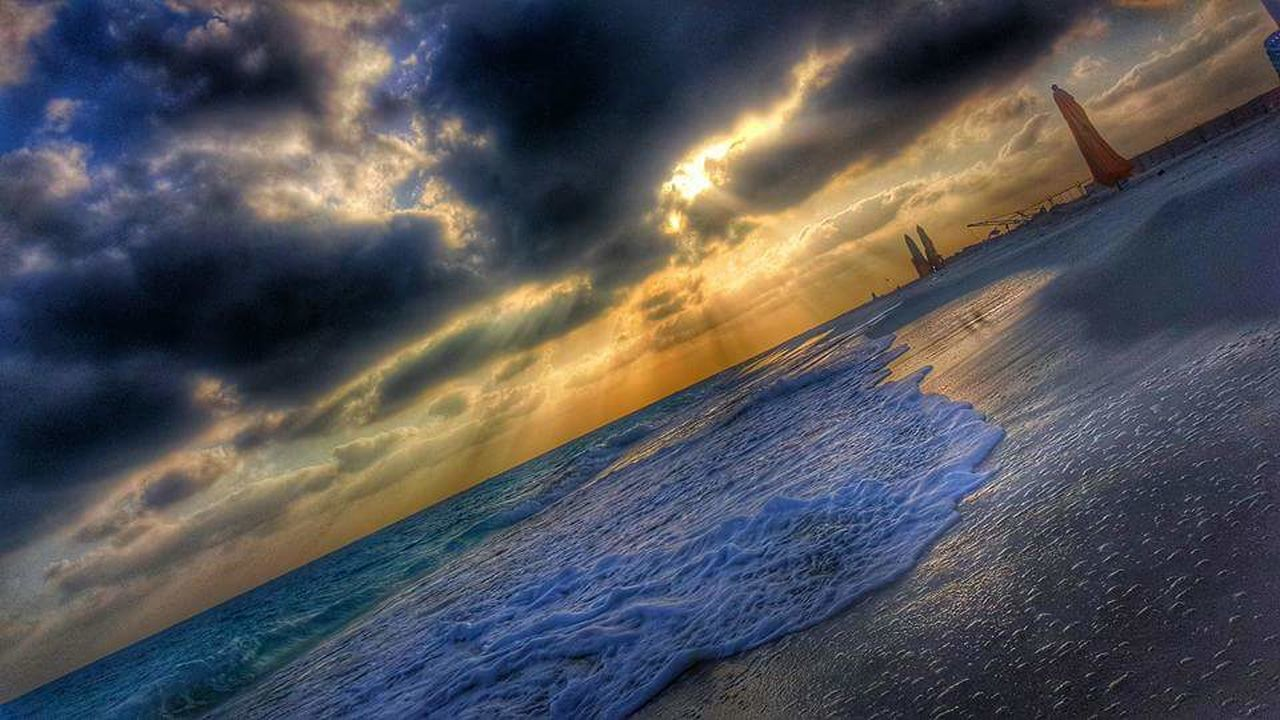 sea, cloud - sky, dramatic sky, sunset, horizon over water, nature, scenics, wave, beauty in nature, sky, outdoors, beach, water, no people, awe, storm cloud, landscape, day, power in nature, close-up