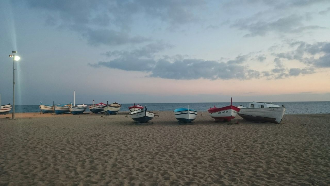 beach, sand, sea, shore, water, nature, horizon over water, tranquility, sky, tranquil scene, nautical vessel, beauty in nature, scenics, outdoors, no people, moored, day, sunset, jet boat, pebble beach