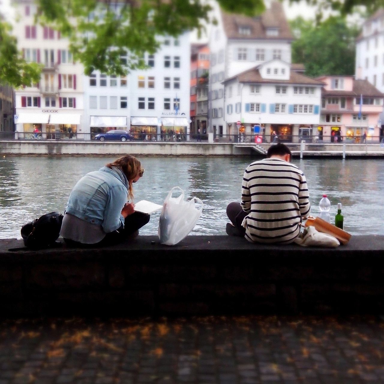 water, real people, rear view, sitting, built structure, building exterior, architecture, two people, togetherness, day, men, leisure activity, canal, casual clothing, women, nautical vessel, full length, lifestyles, outdoors, adult, people