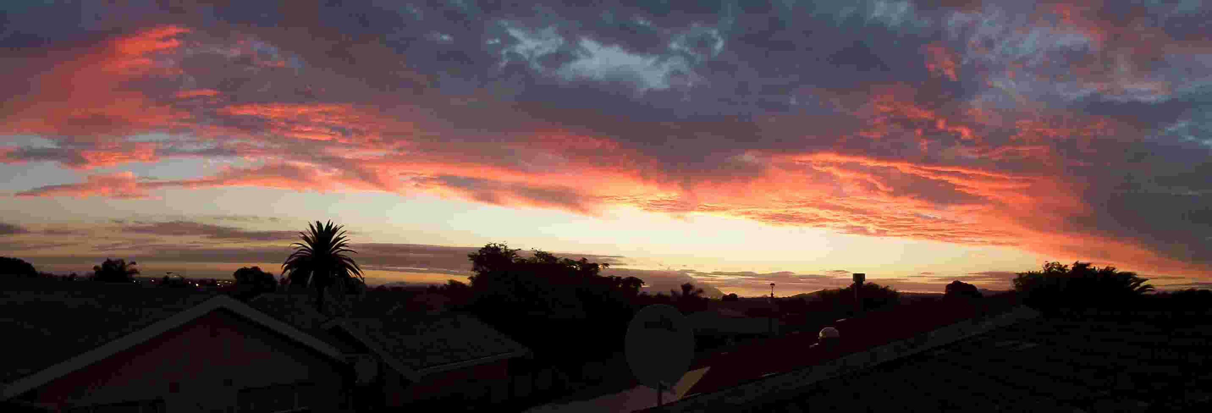 sunset, building exterior, architecture, built structure, sky, orange color, house, cloud - sky, residential structure, town, residential building, city, silhouette, outdoors, dusk, high angle view, scenics, nature, sun, sunlight