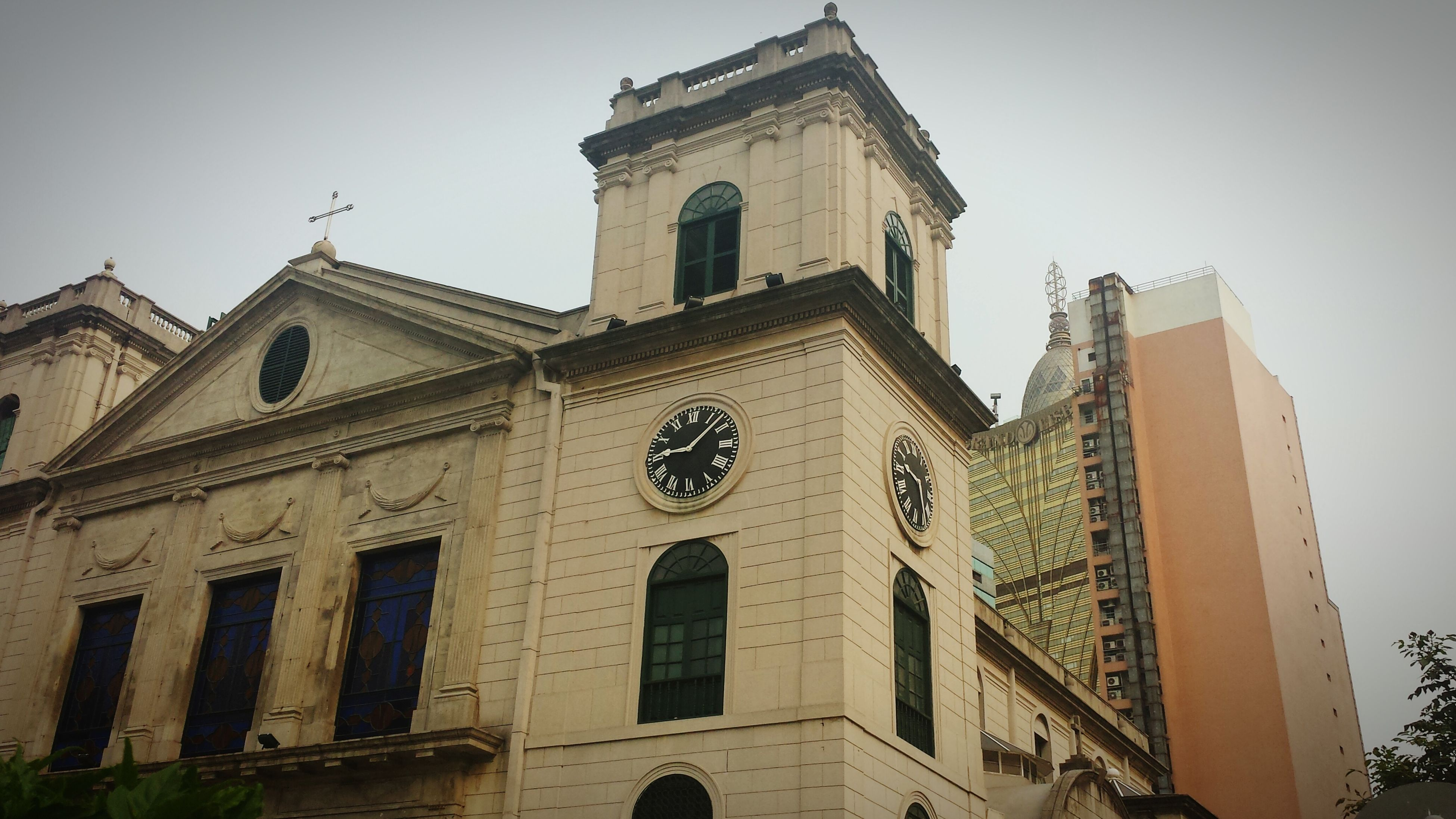 architecture, building exterior, built structure, low angle view, church, clear sky, window, religion, place of worship, sky, clock tower, tower, high section, spirituality, history, facade, day, clock