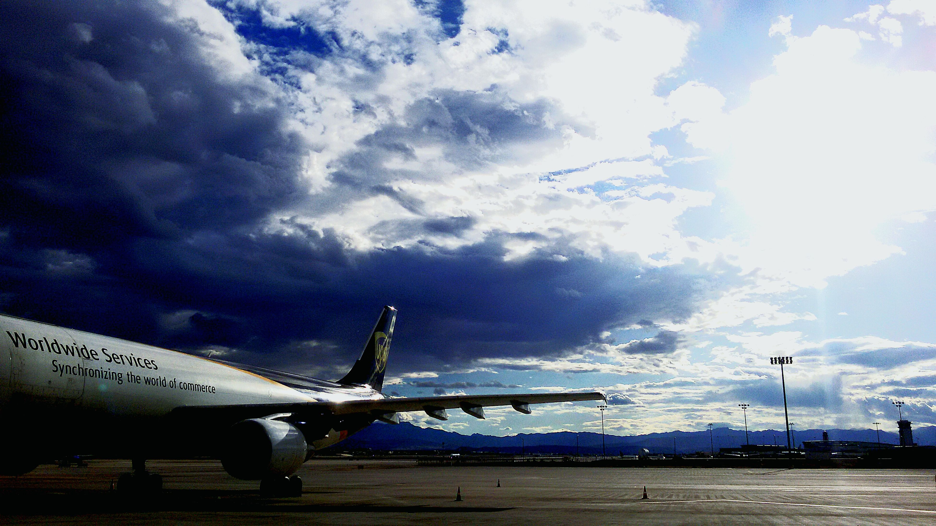 transportation, sky, mode of transport, cloud - sky, airplane, flying, air vehicle, cloudy, cloud, low angle view, mid-air, travel, nature, day, on the move, outdoors, sunlight, aircraft wing, car, no people