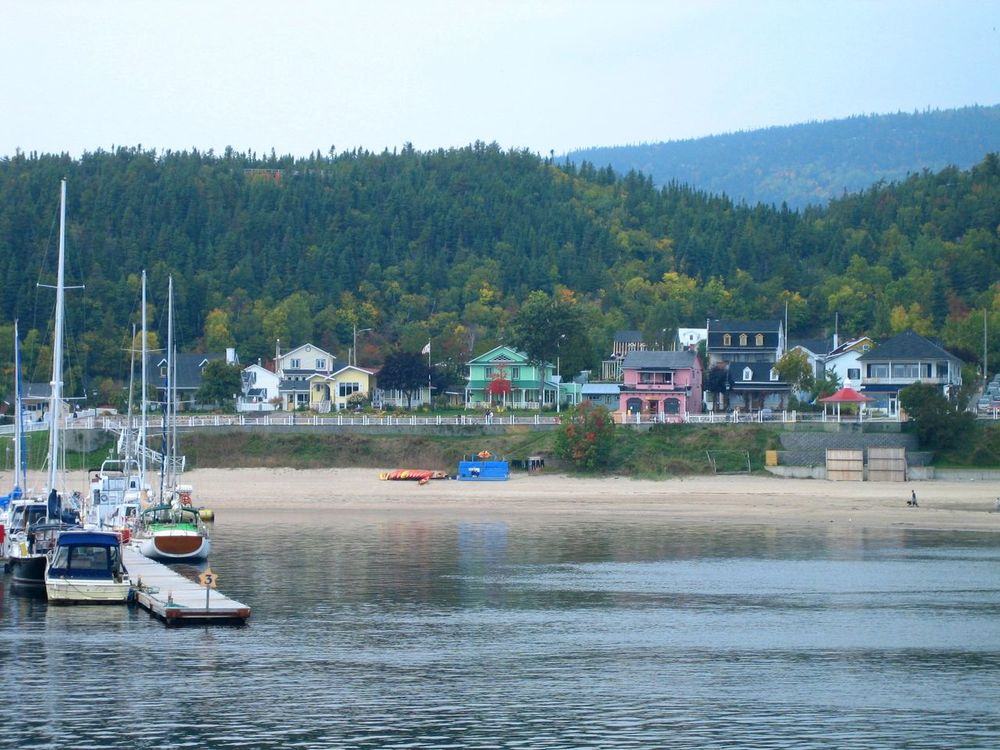 The place name is Tadoussac, Québec, Canada; the starting point of our exciting whale watch trip. Beauty In Nature Boat Canada Canadian Tourism Green Hills Growth Idyllic Moored Boats Nature Nautical Vessel No People River River Shore Scenics Tadoussac Tadoussac Beach Tadoussac, Canada Town Tranquil Scene Tranquility View From The Ship View From The Water Water Waterfront