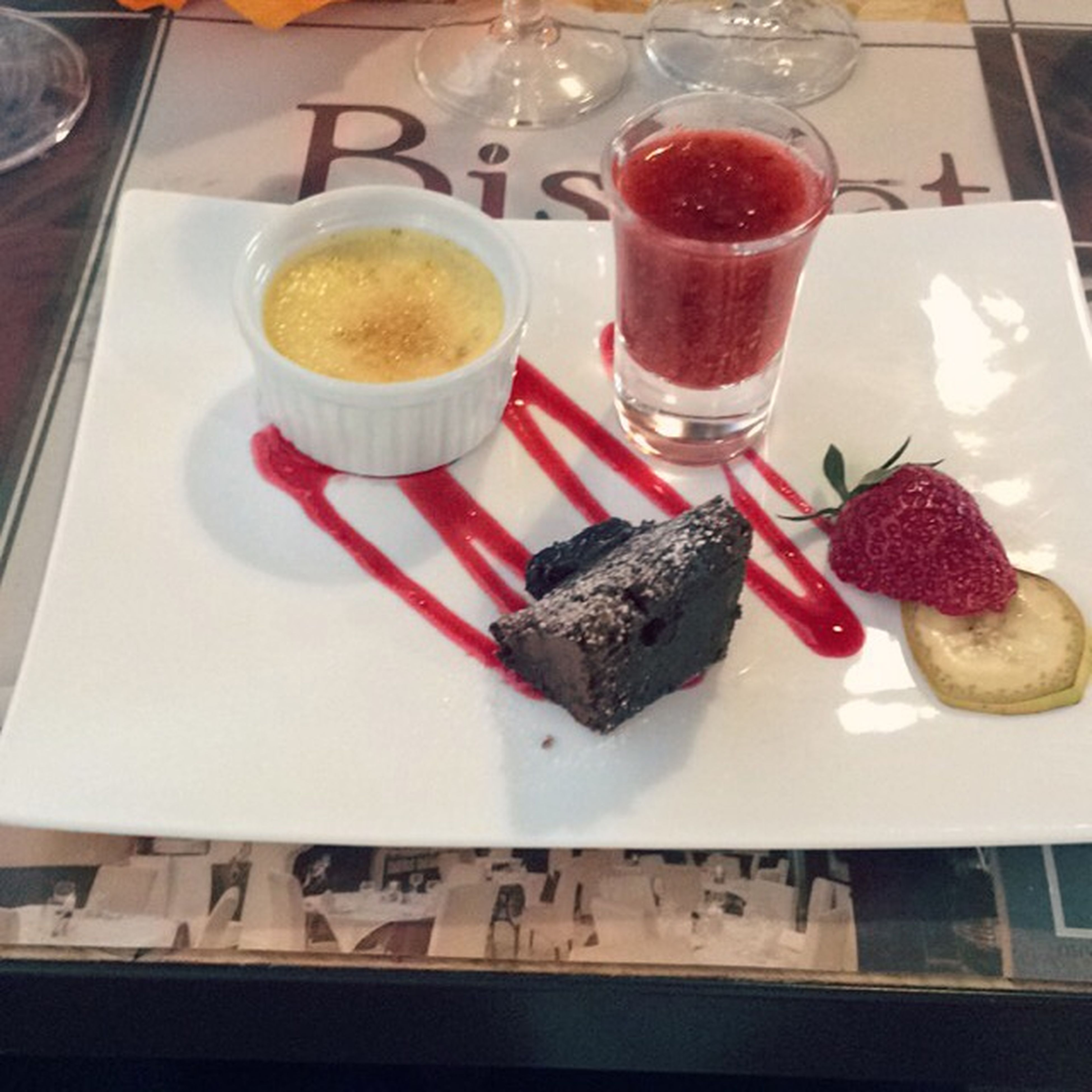 food and drink, food, freshness, indoors, ready-to-eat, plate, still life, table, sweet food, indulgence, strawberry, serving size, fork, drink, dessert, unhealthy eating, high angle view, drinking glass, cake