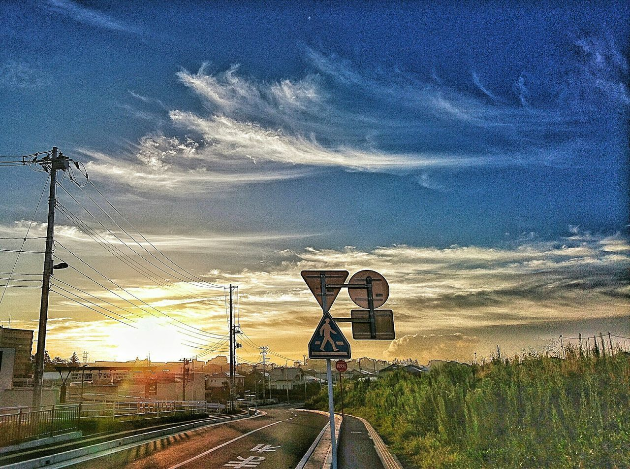 sky, transportation, communication, cloud - sky, rail transportation, railroad track, sunset, road sign, no people, road, electricity pylon, landscape, outdoors, railway signal, nature, day, tree