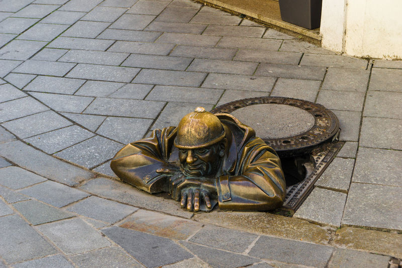 Bratislava, Slovakia old town Bratislava, Slovakia Bronze Cumil Day Elevated View Footpath No People Outdoors Pavement Paving Stone Sculpture Watching