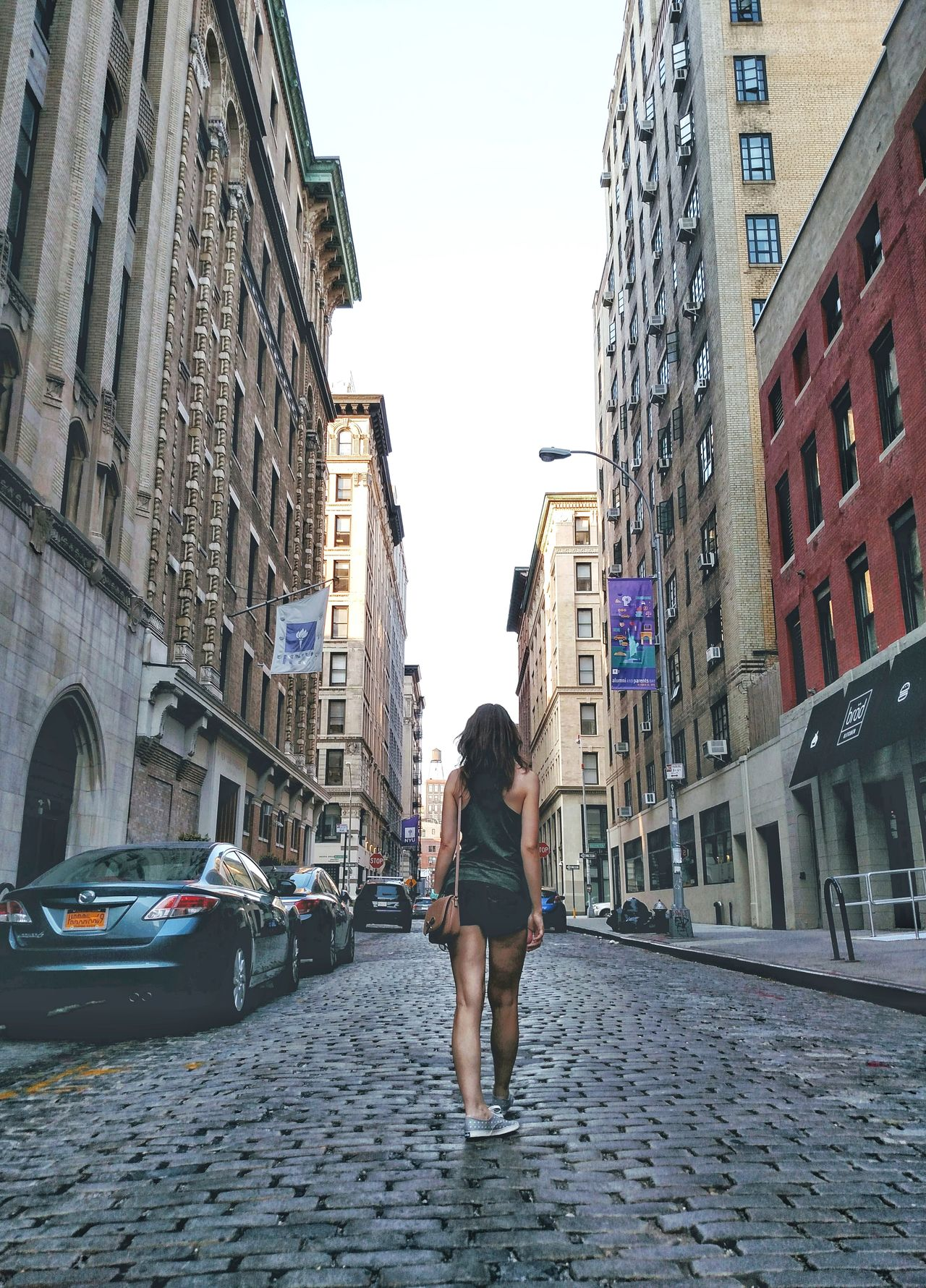Architecture City Building Exterior Travel Destinations Street Built Structure People One Person Full Length Adults Only Outdoors Only Women Women One Woman Only Adult Day One Young Woman Only NYC Facade Building Urban New York City Manhattan Perspective Brick Wall Downtown