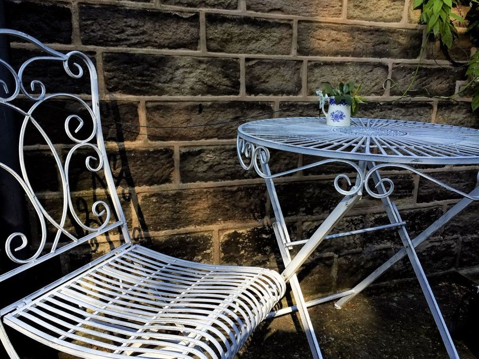 Time to reflect Chair Garden Oudoors Plants Shadows Table Table And Chair Wall White Metal Table And Chair White Table And Chair