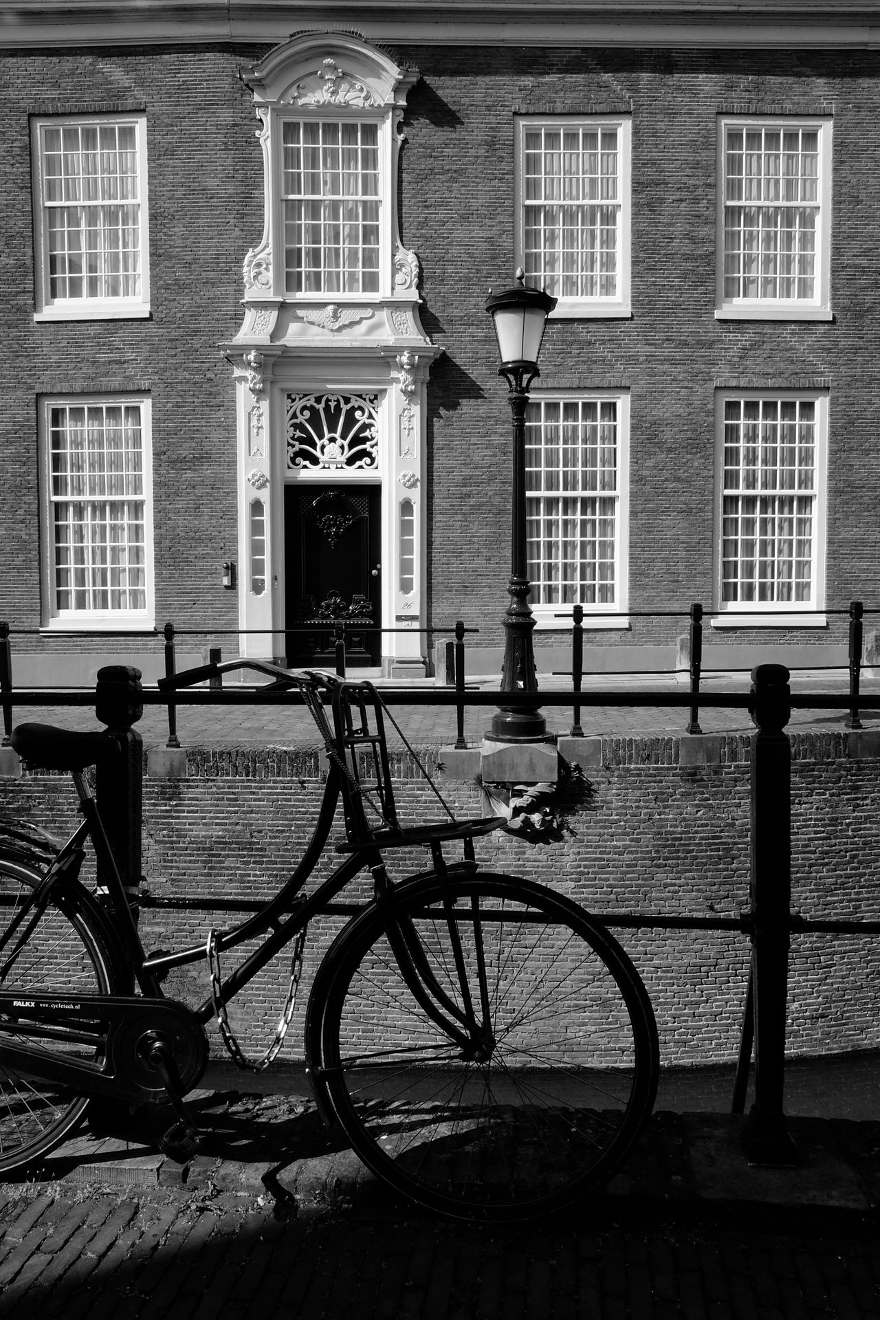 Bicycle and building Architecture B&w Bicycle Blackandwhite Building Exterior Built Structure City City Day Land Vehicle Mode Of Transport Monochrome No People Outdoors Shadow Sidewalk Stationary Transportation Urban Utrecht
