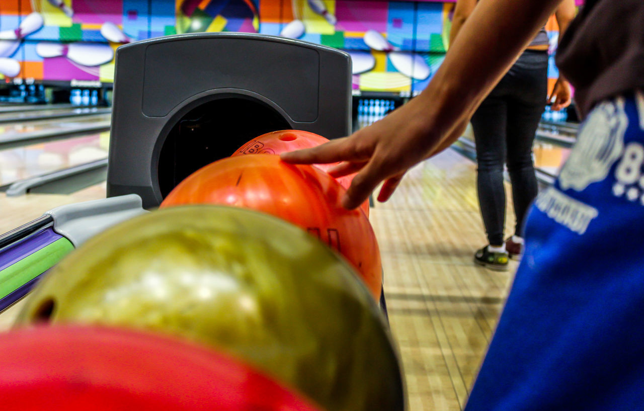 Adult Adults Only Bowling Bowling Alley Bowling Balls Buying Consumerism Customer  Human Body Part Human Hand Indoors  Men One Person People Photography Playing Real People Retail  Shopping Mall Sports Store Supermarket Taking Photos The Week Of Eyeem Women
