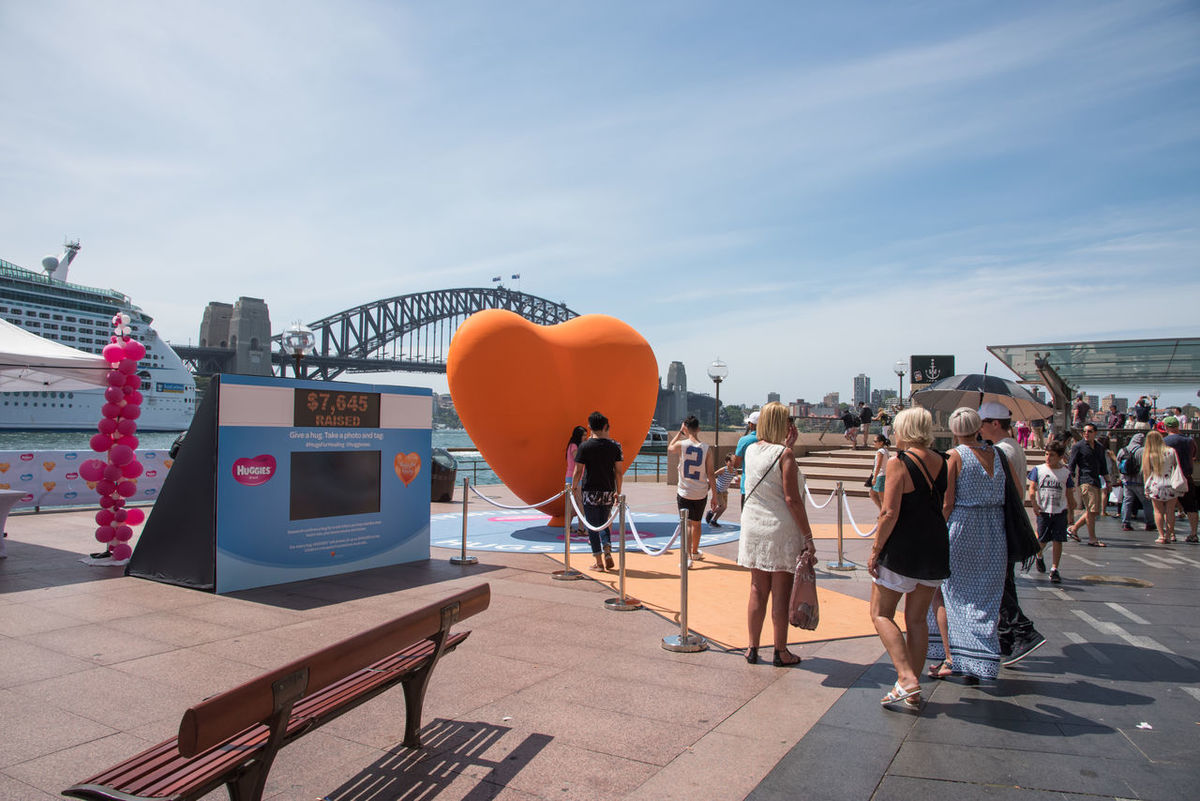 Sydney,NSW,Australia-November 20,2016: Circular Quay with tourists by Children's Hospital Foundation fundraiser with giant love heart and harbour view in Sydney, Australia. Australia Children's Hospital  Harbour LED Sydney Harbour Bridge Tourist Volunteer Waiting In Line Arch Awareness Charity Circular Quay Donation Funding Fundraiser Giving Heart Heart Shape Help Money Nautical Vessel Real People Sydney Tourism Waterfront