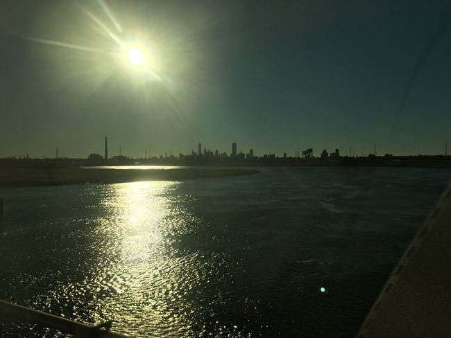 Beauty In Nature Blue Bright Brightly Lit Calm City Cityscape Day Distant Harbor Lens Flare Nature Reflection Scenics Shining Sky Skyline Sun Sunbeam Sunlight Sunny Tranquil Scene Tranquility Water Waterfront