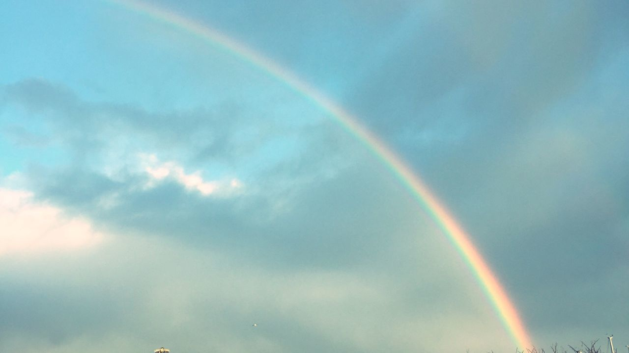 rainbow, double rainbow, multi colored, low angle view, vapor trail, sky, scenics, contrail, nature, beauty in nature, no people, cloud - sky, day, outdoors