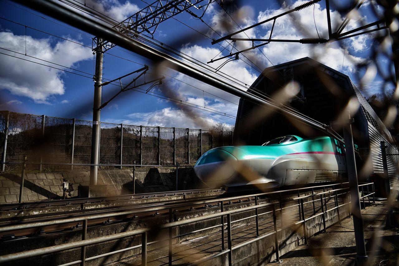 🚅 ⛅Capture The Moment Depth Of Field Fence Focus On Background Transportation Train Japanese  Shinkansen Speed Motion Railway Futuristic Blue Sky Cloud - Sky Tunnel Snapshots Of Life Outdoors Fine Art Getting Inspired Street Photography Full Frame Sigma SONY A7ii EyeEm Best Shots 17_05 Live For The Story BYOPaper! EyeEmNewHere