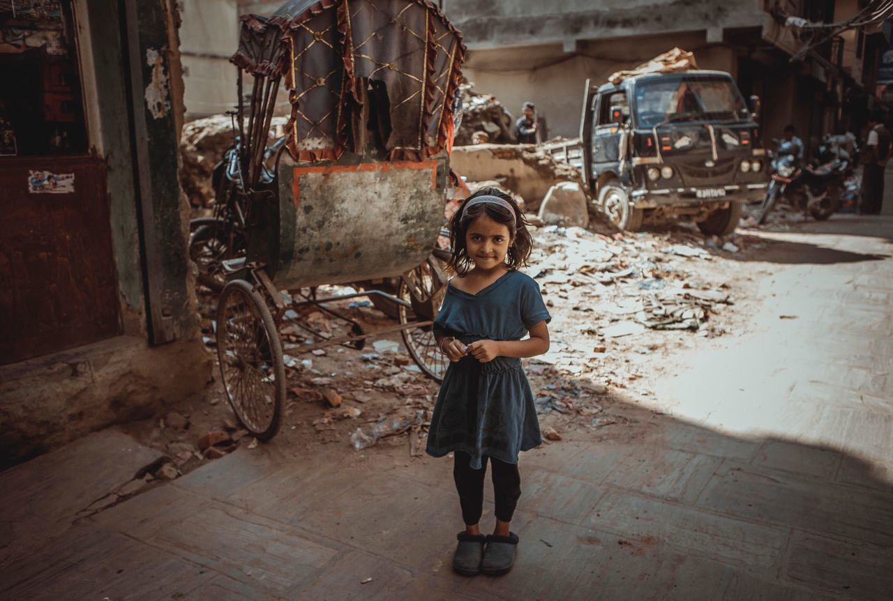 Kathmandu Nepal Dust Dusty Girl Full Length One Person Looking At Camera Child Old City Streetphotography Street Street Photography Portrait Standing Real People Indoors  Children Only Workshop Childhood Smiling People Day Adult