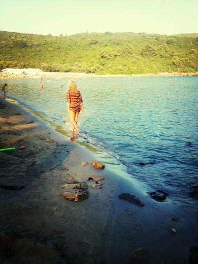 Enjoying The Sun Sea Relaxing Beachwalk