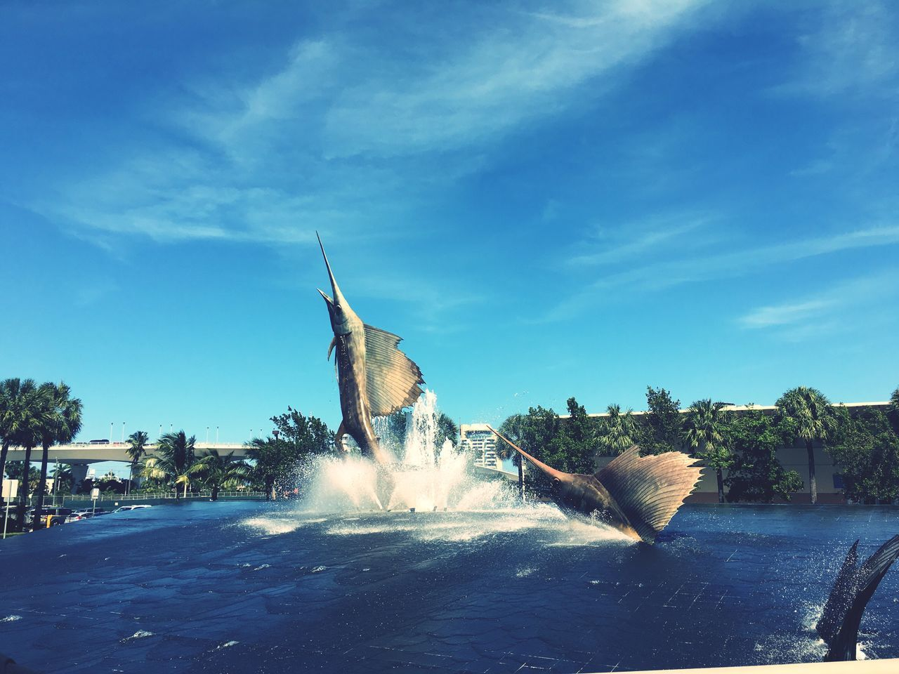 Swordfish Statues In Fountain Against Sky