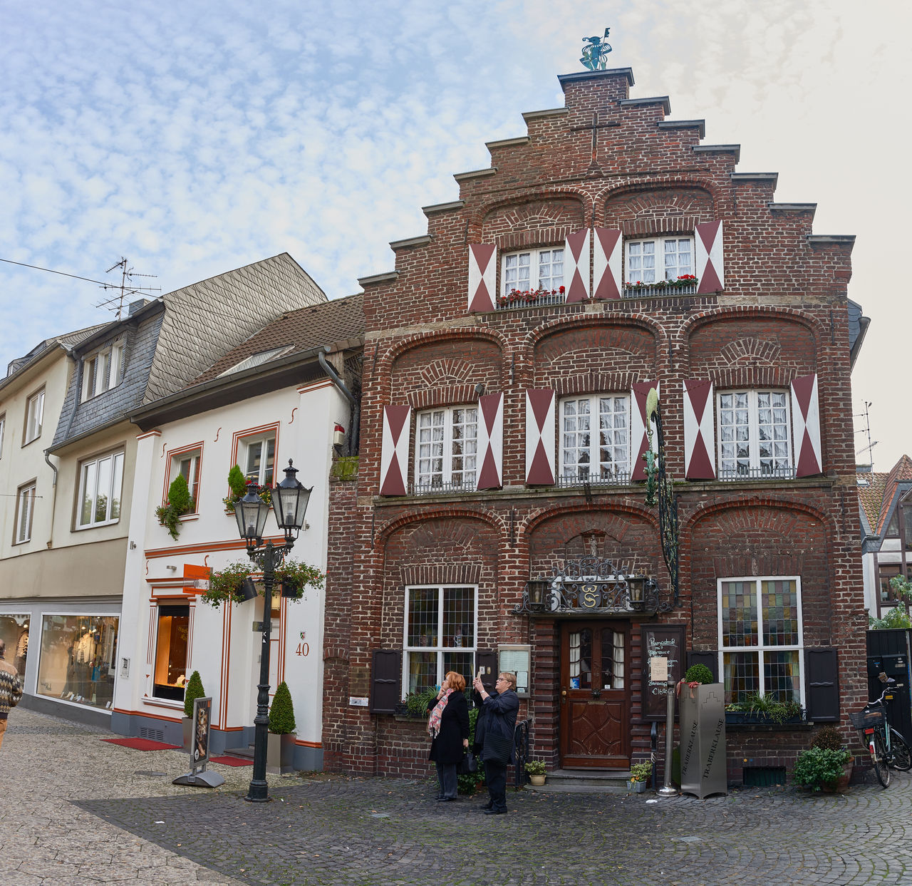 KEMPEN, GERMANY - OCTOBER 26, 2016: One of the oldest historic buildings hosts restaurant. Atmospheric Mood Christanity Colorful Downtown Germany Heritage High Resolution Historic City History Light Love Market Medieval Outdoors People Relaxing Shopping Travel Destination Urban