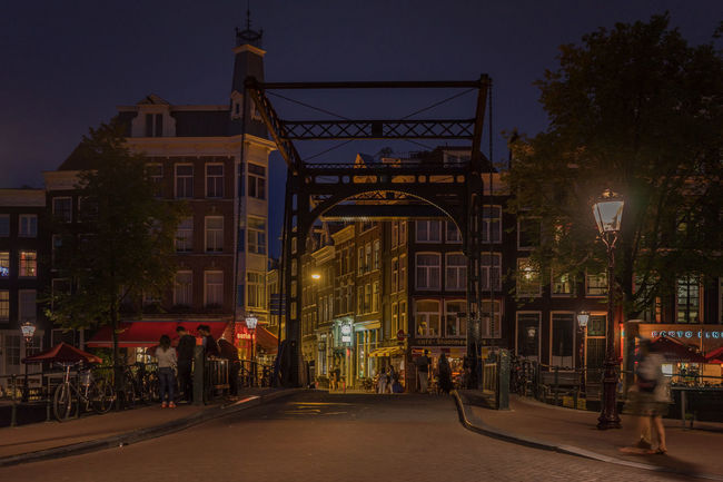Amsterdam, kloveniersburgwal Amsterdam Architecture Bridge Canal Houses Capital Cities  City Life Dutch Evening Historical Building Illuminated Nederland Netherlands Night Street Light Travel Destinations