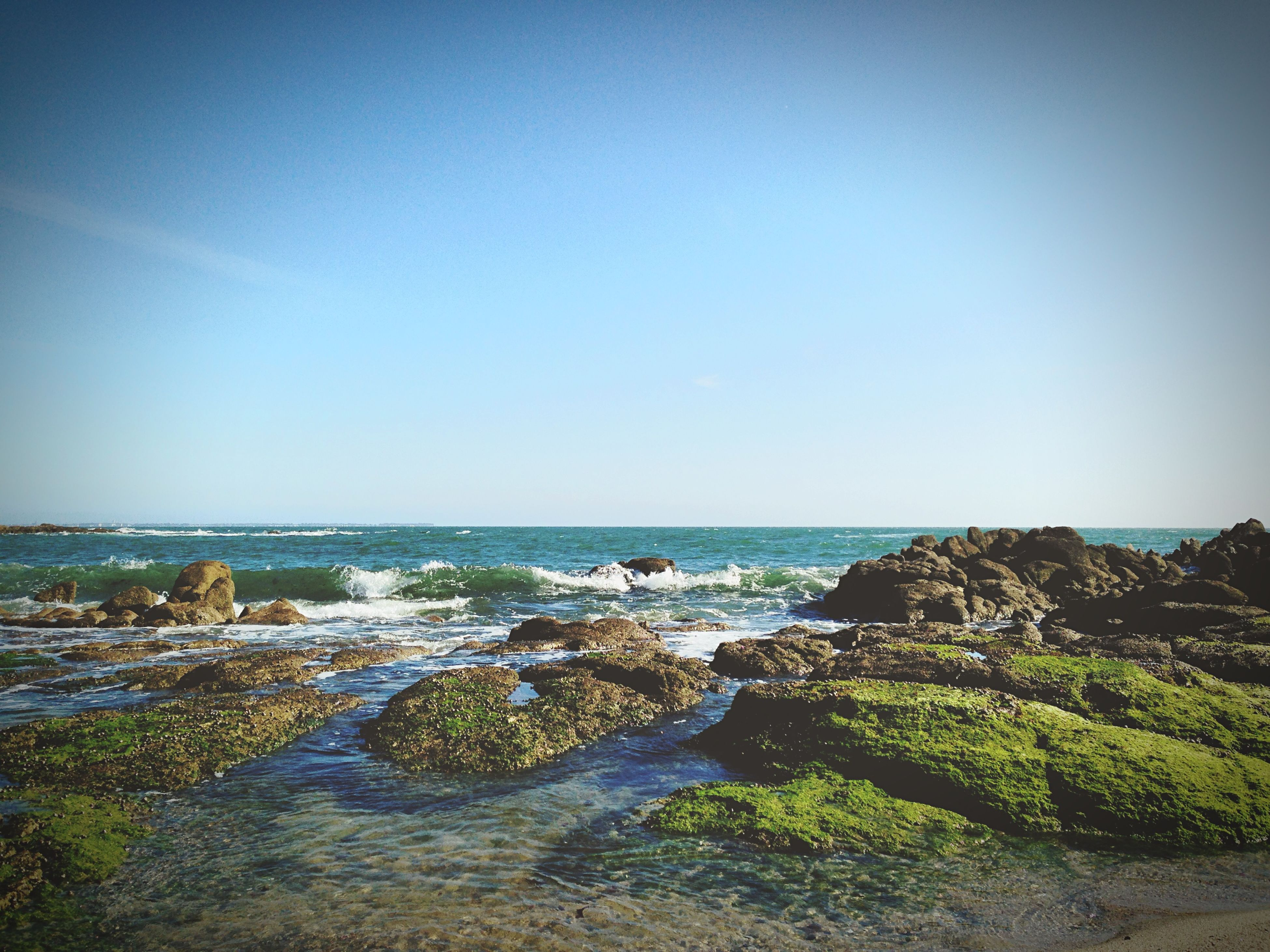 sea, water, horizon over water, scenics, tranquil scene, clear sky, beauty in nature, tranquility, copy space, nature, rock - object, blue, beach, rock formation, coastline, idyllic, shore, cliff, rock, sky