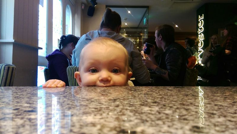 One table to start with Indoors  Child Childhood Domestic Life Lifestyles Family People Table Baby Togetherness Human Body Part Adult Day Hungry Cheeky Funny Cute Baby Babygirl Harvester Restaurant Restaurants Lunchtime Yummy Tabletop Shot