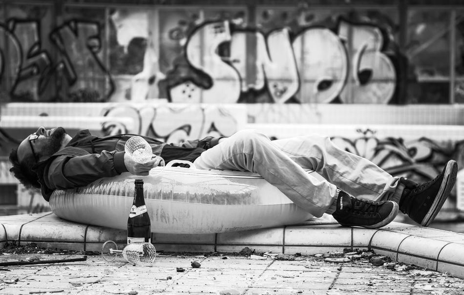 Social Issues Sleeping Lying Down City Men People One Person Outdoors Adult Day Bed Location Shooting Model Fun Schwimmbad Life Life Is A Beach Swimming The Day After Party Man Man Made Object